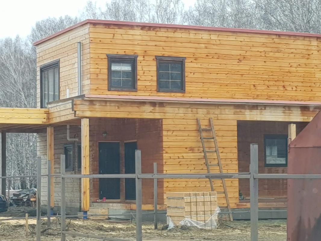 Дом из профилированного бруса с плоской кровлей